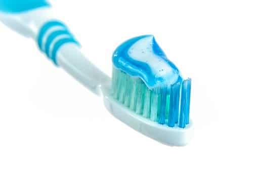 Using toothbrush
